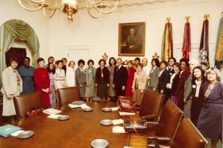 Erma Bombeck at a meeting of President Carter's National Advisory Committee for Women. Rosalynn Carter, President Jimmy Carter, and Lynda Johnson Robb are also pictured. December 16, 1980