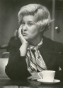 Erma Bombeck fields questions at a morning news conference.
